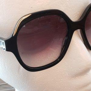 Prada spr 06u sunglasses 52